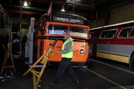 Louis Guzzo, superintendent of diesel maintenance at the Muni's Woods  Division.Superintendent of bus maintenanceshows historic buses including a 1938 White bus (left) and a 1969 GMC bus at the Muni Woods division in Dogpatch in San Francisco, Calif., on Thursday, October 23, 2014.