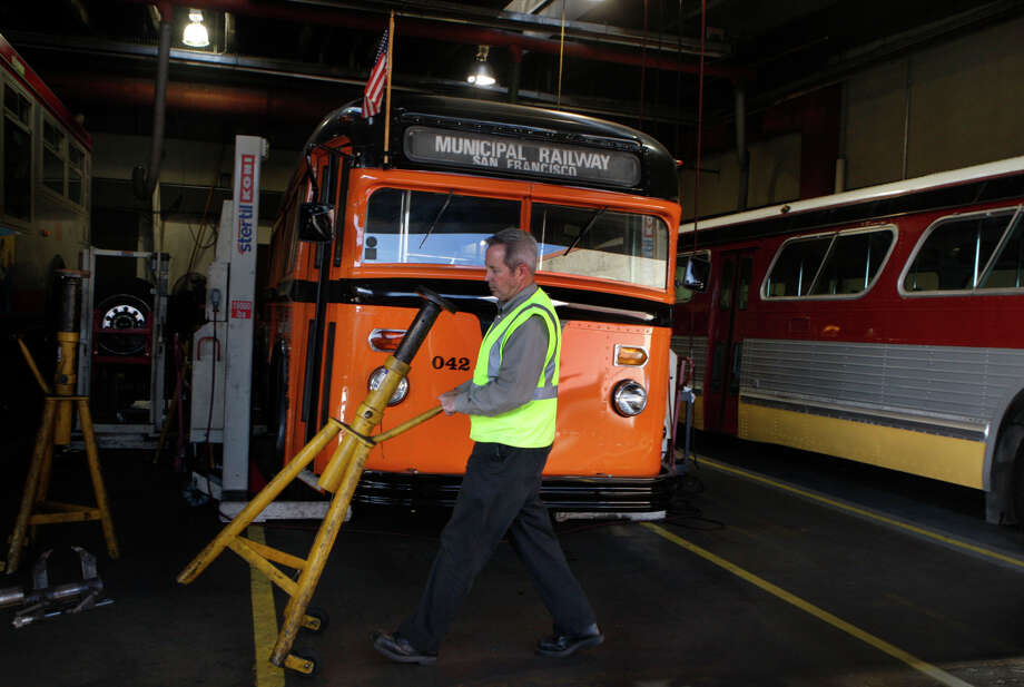 Louis Guzzo, superintendent of diesel maintenance at the Muni's Woods  Division.Superintendent of bus maintenanceshows historic buses including a 1938 White bus (left) and a 1969 GMC bus at the Muni Woods division in Dogpatch in San Francisco, Calif., on Thursday, October 23, 2014. Photo: Liz Hafalia / The Chronicle / ONLINE_YES