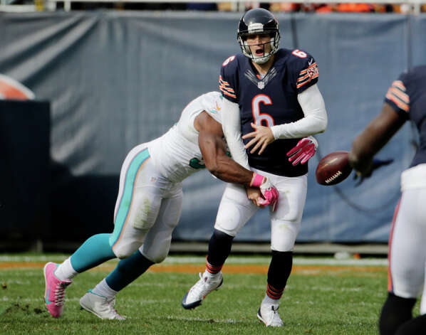 Miami Dolphins defensive end Cameron Wake (91) strips the ball forcing Chicago Bears quarterback Jay Cutler (6) to fumble during the second half of an NFL football game Sunday, Oct. 19, 2014 in Chicago. Wake recovered the ball. (AP Photo/Charles Rex Arbogast) ORG XMIT: CXB159 Photo: Charles Rex Arbogast / AP