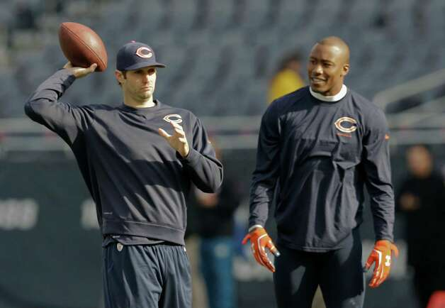 Chicago Bears quarterback Jay Cutler, left, and wide receiver Brandon Marshall warm up before an NFL football game against the Miami Dolphins Sunday, Oct. 19, 2014 in Chicago, (AP Photo/Nam Y. Huh) ORG XMIT: CXB103 Photo: Nam Y. Huh / AP