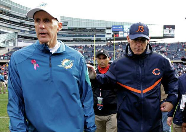 Chicago Bears head coach Marc Trestman, right, congratulates Miami Dolphins head coach Joe Philbin after their NFL football game Sunday, Oct. 19, 2014 in Chicago. The Dolphins won 27-14. (AP Photo/Nam Y. Huh) ORG XMIT: CXB176 Photo: Nam Y. Huh / AP