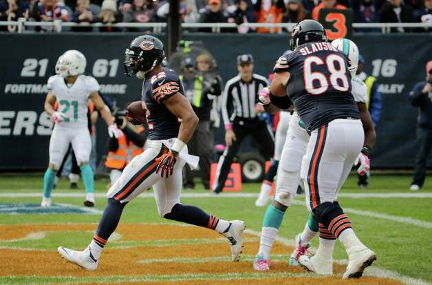Chicago Bears running back Matt Forte (22) runs into the end zone for a touchdown during the second half of an NFL football game against the Miami Dolphins Sunday, Oct. 19, 2014 in Chicago. (AP Photo/Charles Rex Arbogast) ORG XMIT: CXB172 Photo: Charles Rex Arbogast / AP