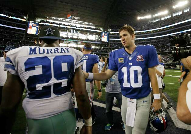 Dallas Cowboys' DeMarco Murray (29) is congratulated by New York Giants' Eli Manning (10) after their NFL football game, Sunday, Oct.  19, 2014, in Arlington, Texas. The Cowboys won 31-21. (AP Photo/Brandon Wade)  ORG XMIT: CBS198 Photo: Brandon Wade / FR168019 AP