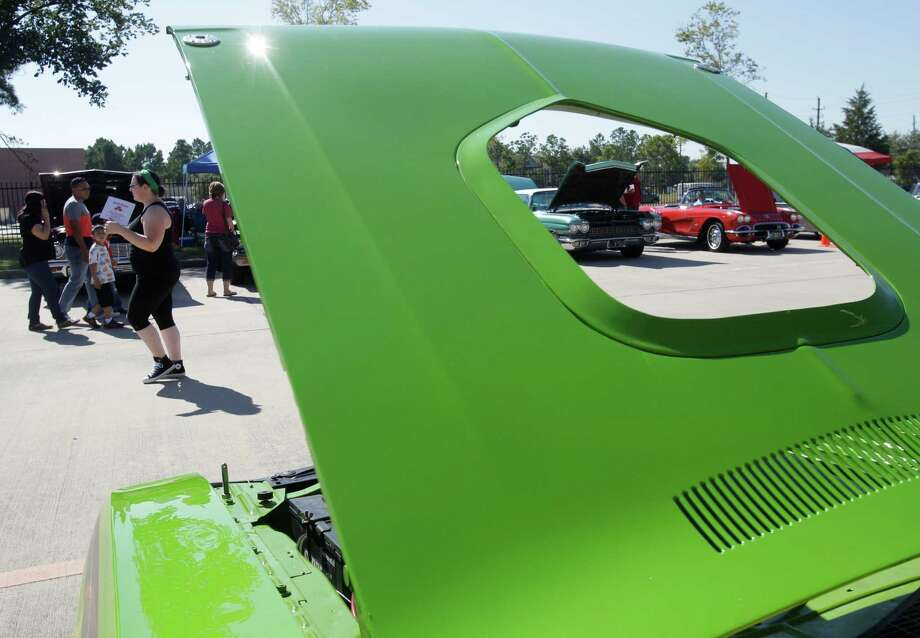 The hood of a 1971 Dodge Challenger convertible is shown during the Blast from the Past Street Machines of Texas car show at the National Museum of Funeral History, 415 Barren Springs Drive, Saturday, Oct. 25, 2014, in Houston. Photo: Melissa Phillip, Houston Chronicle / © 2014  Houston Chronicle