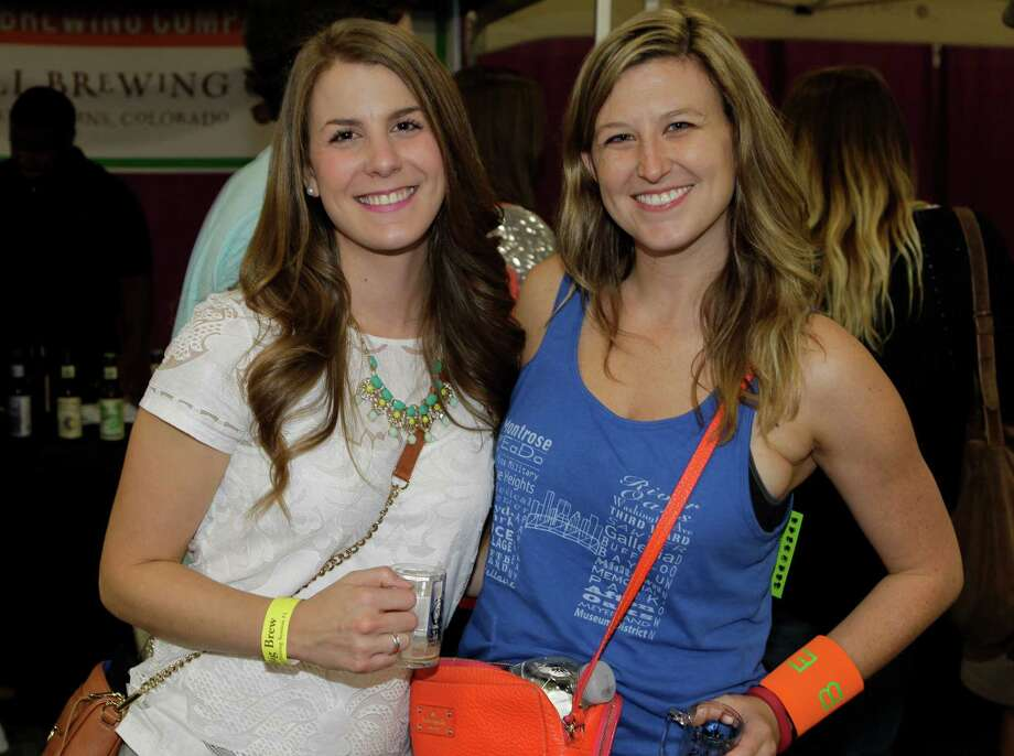 People pose during the Big Brew craft beer festival at George R. Brown on Saturday, Oct. 25, 2014, in Houston. Photo: Melissa Phillip, Houston Chronicle / © 2014  Houston Chronicle
