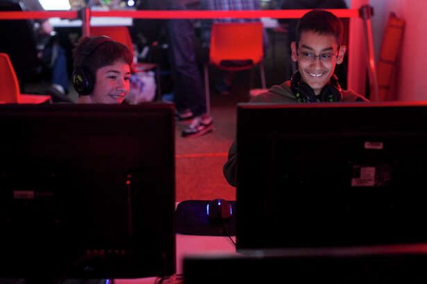 Tyler Colsan, 15, and Jonathan Vargas, 15, get ready to start playing Saturday October 25, 2014 during the Extra Life's National Game Day, a nationwide event where gamers play video games for 24 hours to raise money for Children's Miracle Network Hospitals. Rackspace employees called RackerGamers hosted the Extra Life broadcast site at Rackspace.