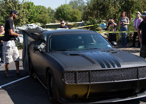 photo of Tim Duncan  - car