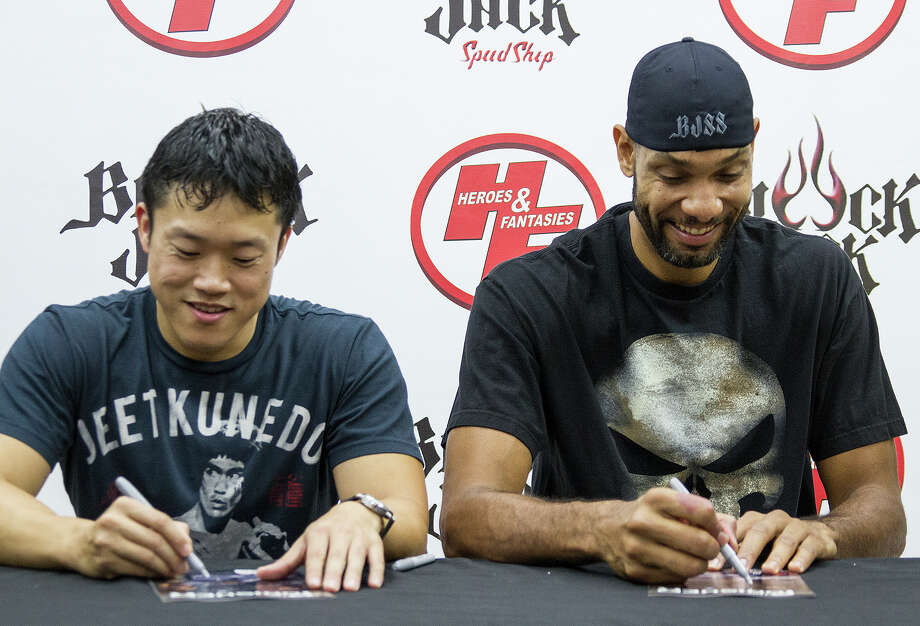 "Mike Choi and Tim Duncan sign their special issue ""The Punisher"" comic for fans at Heroes and Fantasies, Saturday, Oct. 25, 2014. The comic was drawn by artist Mike Choi who grew up in San Antonio. Photo: Alma E. Hernandez, Alma E. Hernandez / For The San"