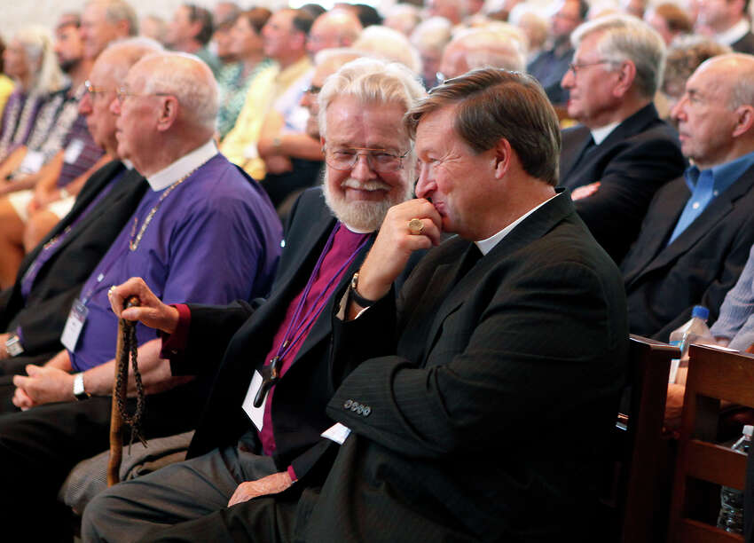 Robert Hibbs (left), a retired bishop suffragan,looks over at the Rt. Rev. David Reed Saturday Oct. 25, 2014 as Reed returned to his seat after giving a short speech when it was announced he was elected coadjutor bishop of the Episcopal Diocese of West Texas. About 400 delegates from the diocese voted during the special council to elect a bishop coadjutor at TMI-The Episcopal School of Texas. Reed who is currently the Bishop Suffragan of the Diocese, was one out of six nominees for the position and won on the first ballot taken, which has only happened one other time, in 1943. Reed will take over in 2017 when the current bishop, the Rt. Rev. Gary Lillibridge will retire.