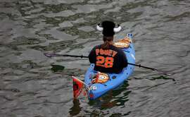 A kayaker waits in McCovey Cove before Game 3 of the National League baseball championship series between the San Francisco Giants and the St. Louis Cardinals on Tuesday, Oct. 14, 2014, in San Francisco. (AP Photo/Eric Risberg)