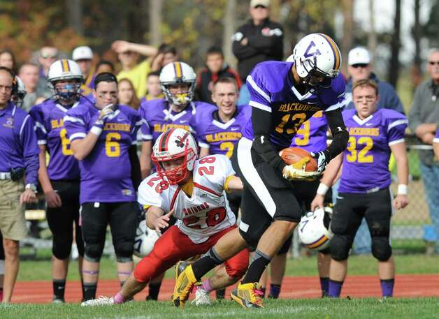 Voorheesville's Mickey Knight pulls in a pass he would take in for a touchdown during their Class C quarterfinal football game  against  Mechanicville on Saturday Oct. 25, 2014 in Voorheesville, N.Y. (Michael P. Farrell/Times Union) Photo: Michael P. Farrell / 00029196A