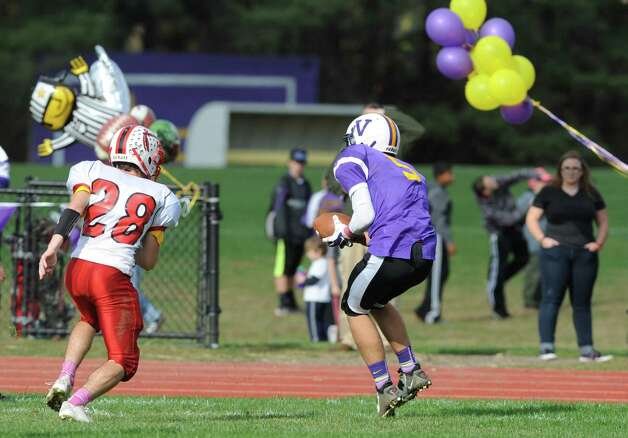 Voorheesville's Shane Parry catches a touchdown pass during their Class C quarterfinal football game  against Mechanicville on Saturday Oct. 25, 2014 in Voorheesville, N.Y. (Michael P. Farrell/Times Union) Photo: Michael P. Farrell / 00029196A
