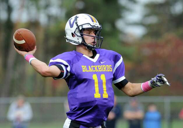 Voorheesville's QB Robert Denman throws deep during their Class C quarterfinal football game  against  Mechanicville on Saturday Oct. 25, 2014 in Voorheesville, N.Y. (Michael P. Farrell/Times Union) Photo: Michael P. Farrell / 00029196A