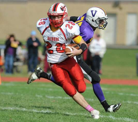 Mechanicville's Jacob Henes returns a kickoff during their Class C quarterfinal football game against Voorheesville on Saturday Oct. 25, 2014 in Voorheesville, N.Y. (Michael P. Farrell/Times Union) Photo: Michael P. Farrell / 00029196A