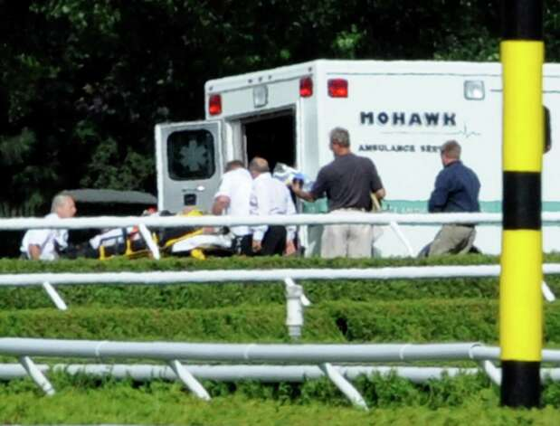 Jockey Javier Castellano on the stretcher is loaded in to a waiting ambulance and transported to the first aid center on the track after his horse Doing Great when down in the final turn and unseated him in The Lucy Scribner Stake at the Saratoga Race Course in Saratoga Springs, New York Aug 11, 2011.    (Skip Dickstein / Times Union) Photo: SKIP DICKSTEIN