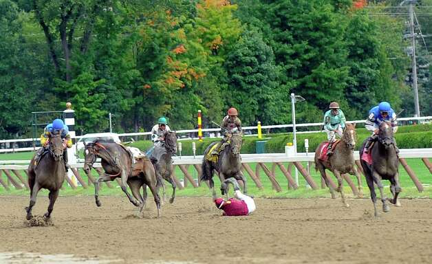 Ludicrus, second from left, is injured as jockey Irad Oritz Jr. is thrown coming down the stretch during the fourth race prior to the running of the Travers Stakes horse race at Saratoga Race Course in Saratoga Springs, N.Y., Saturday, Aug. 23, 2014. (AP Photo /Hans Pennink) ORG XMIT: NYHP105 Photo: Hans Pennink / FR58980 AP