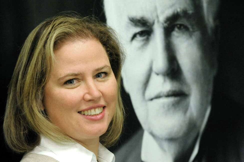 Johanna Wellington, general manager and CTO,of GE Fuel Cells poses in front of a photograph of GE founder Thomas Edison on Tuesday Oct. 21, 2014 in Malta, N.Y. (Michael P. Farrell/Times Union)