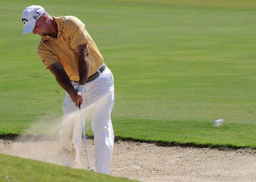Marco Dawson hits out of a bunker during day 2 of the 30th annual AT&T Championship at TPC San Antonio on Saturday, Oct. 25, 2014.