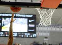 Connecticut's Ryan Boatright (11) shoots over Phillip Nolan during a game at the men's and women's NCAA basketball teams' First Night event, Friday, Oct. 17, 2014, in Storrs, Conn. (AP Photo/Jessica Hill)