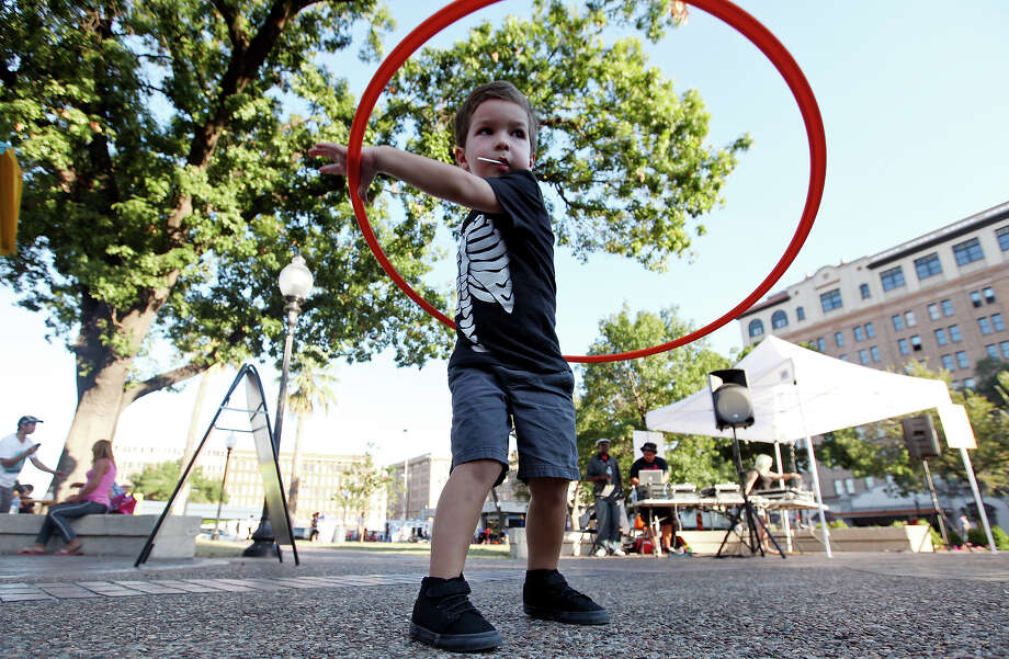 Elijah Antalek, 3, hula hoops during the Fall Festival held Saturday Oct. 25, 2014 in Travis Park. Photo: Edward A. Ornelas, San Antonio Express-News / © 2014 San Antonio Express-News
