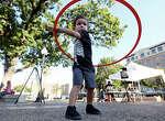 Elijah Antalek, 3, hula hoops during the Fall Festival held Saturday Oct. 25, 2014 in Travis Park.