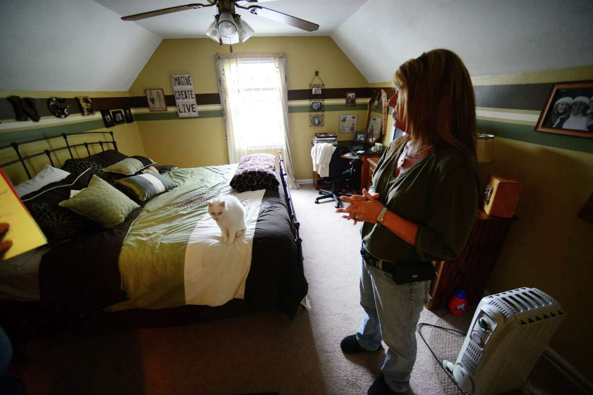 Patty Farrell of Colonie stands in the bedroom where her daughter, Laree, died of a heroin overdose at Farrell's home in Colonie, N.Y. Farrell was interviewed Thursday May 22, 2014, in Colonie, N.Y. (Will Waldron/Times Union)