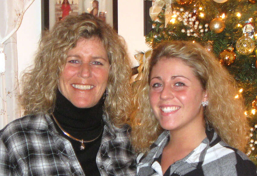 Patty Farrell, left, and her late daughter, Laree Farrell-Lincoln are pictured next to their Christmas tree in a undated photo. Laree died of a heroin overdose at her mother's home March 16, 2013. (Courtesy Patty Farrell)