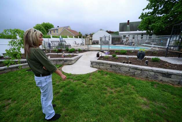 Patty Farrell of Colonie views a remembrance garden she made for her daughter, Laree, Thursday,  May 22, 2014, at Farrell's home in Colonie, N.Y. Laree died of a heroin overdose at her mother's home March 16, 2013. (Will Waldron/Times Union) Photo: WW / 00027007A