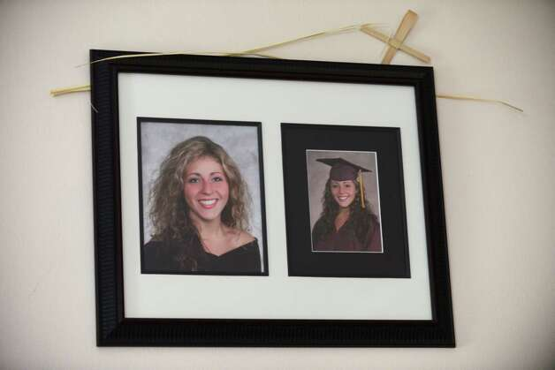 Photos of Laree Farrell hang in her mother's, Patty Farrell, home Thursday,  May 22, 2014, in Colonie, N.Y. Laree died of a heroin overdose at her mother's home March 16, 2013. (Will Waldron/Times Union) Photo: WW / 00027007A
