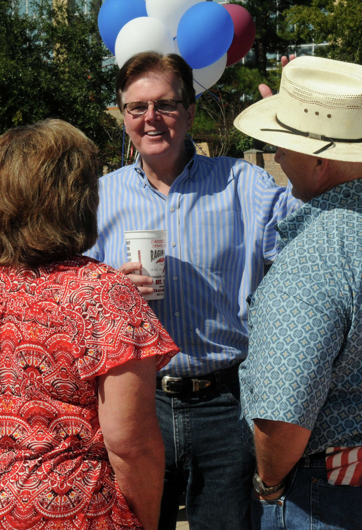GOP candidate for lieutenant governor Dan Patrick visits with Buck Buchanan, right, of Humble, and his wife, Pat, during a rally in Spring.