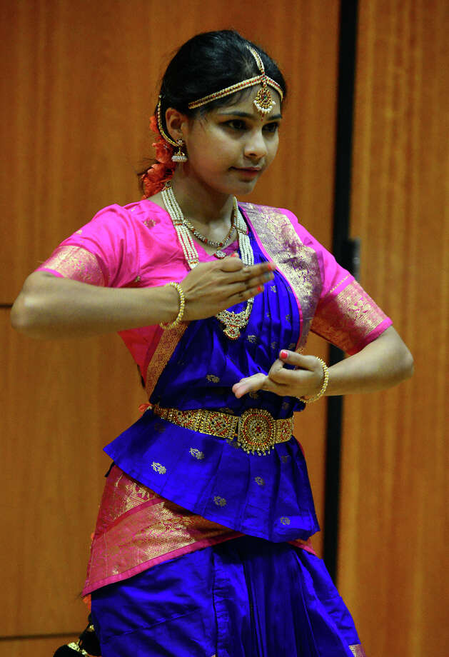 Shravya Geeda performs a traditional Indian dance to help celebrate the first day of Dawali, one of the biggest festivals of the year for Hindus, during a program held at Sacred Heart University's Schine Auditorium in Fairfield, Conn. on Saturday October 25, 2014. The Diwali celebration almost always includes colorful varieties of fireworks. Celebrants light up diyas and candles all around their homes, perform Laxmi Puja in the evening and seek the divine blessings of the Goddess of Wealth. The festival of Diwali also includes the exchange of gifts among loved ones. Photo: Christian Abraham / Connecticut Post