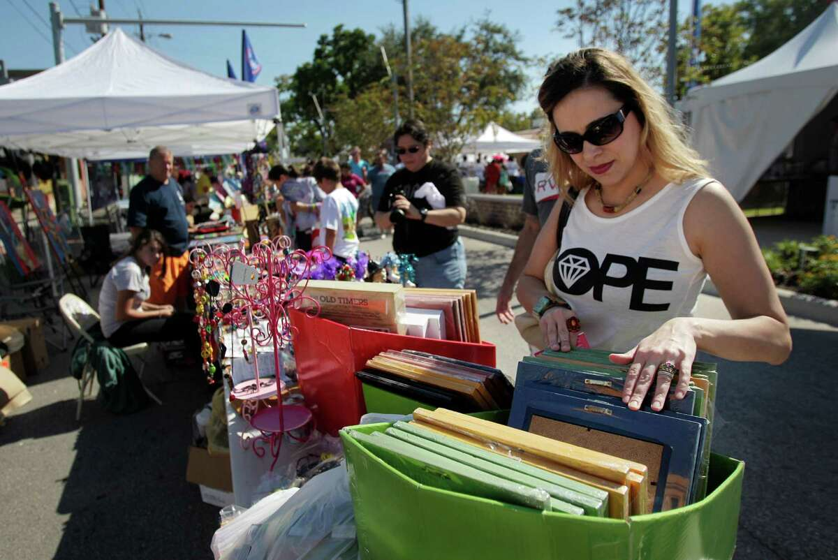 Nichol Gossage, of Dickerson, shops during The East End Street Festival on Saturday, Oct. 25, 2014, in Houston.