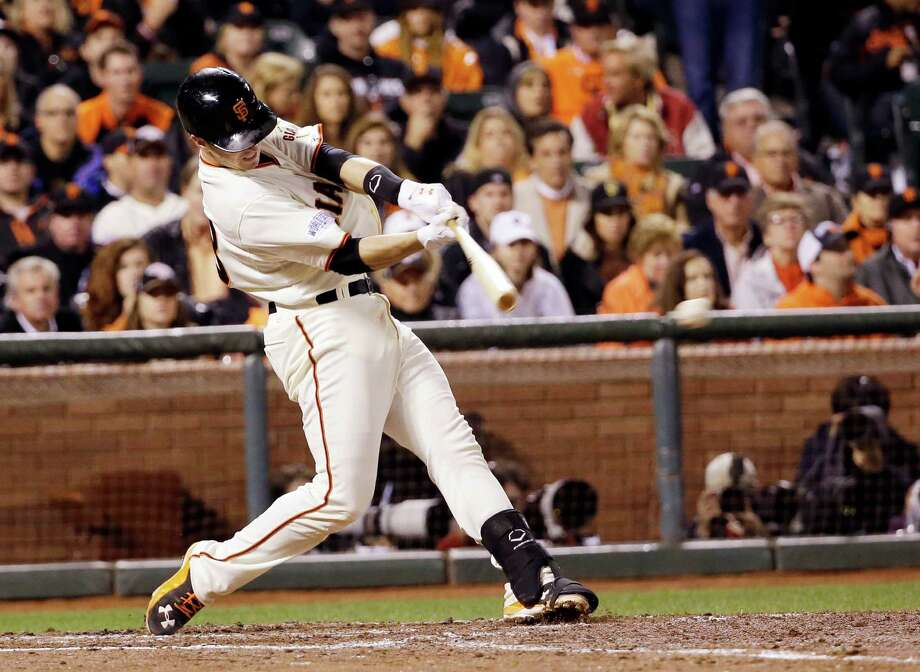 San Francisco Giants' Buster Posey hits an RBI single during the third inning of Game 4 of baseball's World Series against the Kansas City Royals Saturday, Oct. 25, 2014, in San Francisco. (AP Photo/David J. Phillip) Photo: David J. Phillip, Associated Press / AP