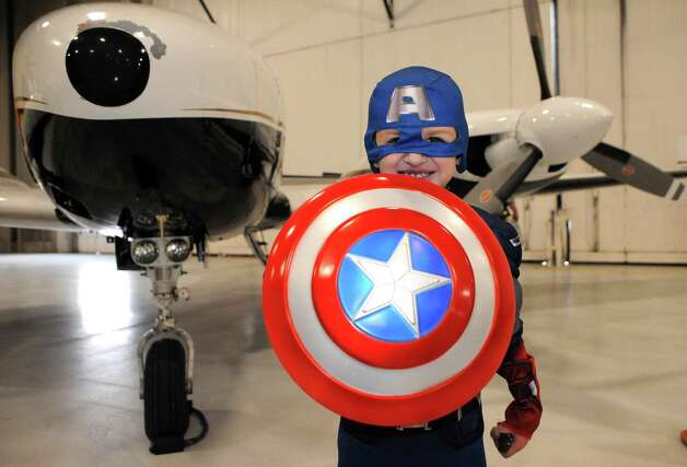 Five-year-old Darin Vail of Athens dressed as Captain America for the Southwest Airlines hosted annual Halloween party for wish kids from Make-A-Wish Northeast New York in the Hildt Aviation Hangar at Albany International Airport on Saturday Oct. 25, 2014 in Colonie, N.Y. (Michael P. Farrell/Times Union) Photo: Michael P. Farrell / 00029167A