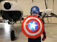 Five-year-old Darin Vail of Athens dressed as Captain America for the Southwest Airlines hosted annual Halloween party for wish kids from Make-A-Wish Northeast New York in the Hildt Aviation Hangar at Albany International Airport on Saturday Oct. 25, 2014 in Colonie, N.Y. (Michael P. Farrell/Times Union)