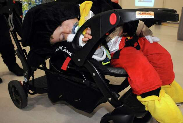 Alex Tremblay, 1 1/2-years-old, of Latham dressed as Mickey Mouse takes a nap during the Southwest Airlines hosted annual Halloween party for wish kids from Make-A-Wish Northeast New York in the Hildt Aviation Hangar at Albany International Airport on Saturday Oct. 25, 2014 in Colonie, N.Y. (Michael P. Farrell/Times Union) Photo: Michael P. Farrell / 00029167A
