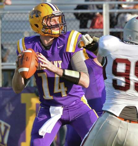 UAlbany quarterback Will Fiacchi looks for receivers  during Saturday's game against Colgate at Bob Ford Field  Oct. 25, 2014, in Albany, NY.  (John Carl D'Annibale / Times Union) Photo: John Carl D'Annibale / 00029094A