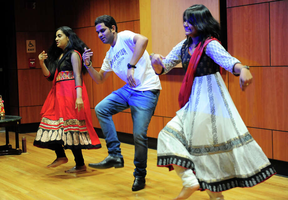 Students at Sacred heart University celebrate of the first day of Dawali, one of the biggest festivals of the year for Hindus, in a program held at school's Schine Auditorium in Fairfield, Conn. on Saturday October 25, 2014. The program included Indian food, a fashion show, and traditional as well as modern Indian dance. The Diwali celebration almost always includes colorful varieties of fireworks. Celebrants light up diyas and candles all around their homes, perform Laxmi Puja in the evening and seek the divine blessings of the Goddess of Wealth. The festival of Diwali also includes the exchange of gifts among loved ones. Photo: Christian Abraham / Connecticut Post