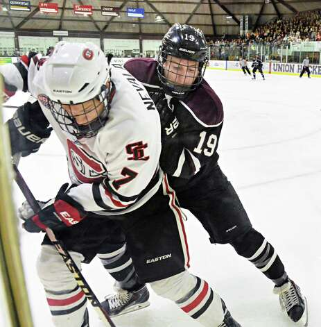 Union's #1Matt Wilkins, right, and St. Cloud State's #7 Nildas Nevalainen up against the boards during Saturday's game at Messa Rink Oct. 25, 2014, in Schenectady, NY.  (John Carl D'Annibale / Times Union) Photo: John Carl D'Annibale / 00029151B