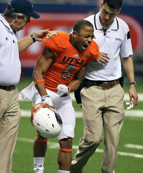 Roadrunner running back Brandon Armstrong shouts in disgust after being helped off the field immediately following his fumble in the second half as UTSA is shut out by UTEP 34-0  at the Alamodome on October 25, 2014. Photo: TOM REEL