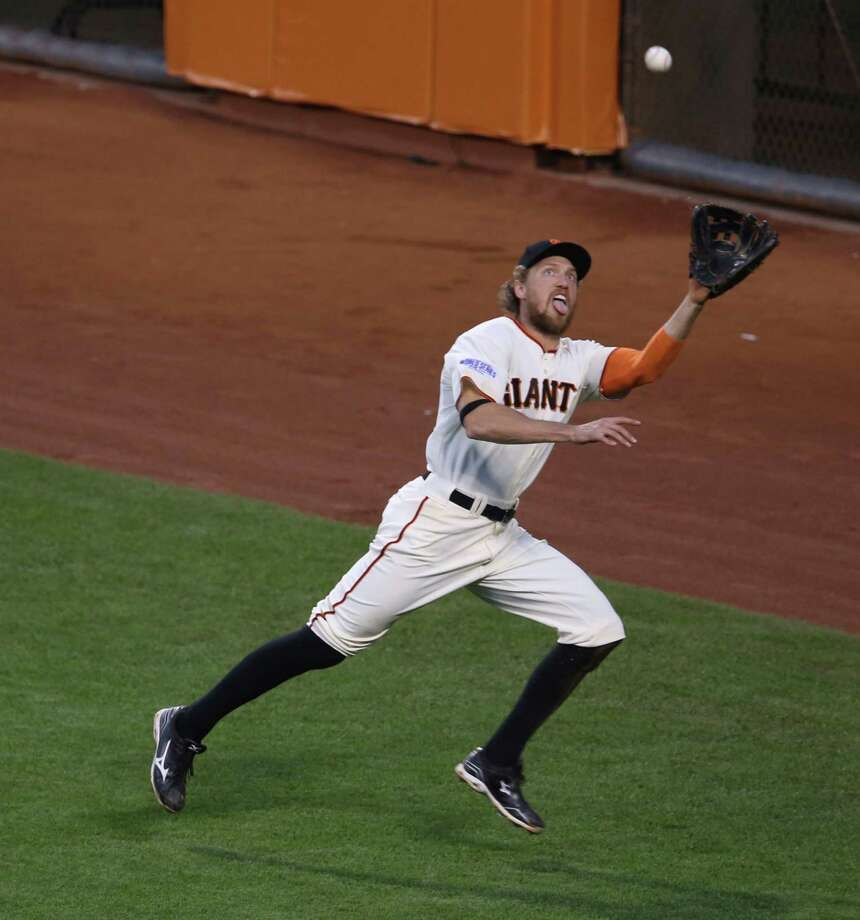 Giants right fielder Hunter Pence attacks every fly ball, including this one by the Royals' Lorenzo Cain on Friday night, with the same intensity, whether it is the third game of the World Series or the third game of the season. Photo: Jane Tyska, MBR / Oakland Tribune