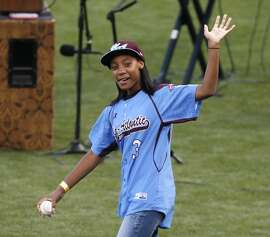 Little League pitcher Mo'ne Davis waves to the crowd before Game 4 of the World Series at AT&T Park on Saturday, Oct. 25, 2014 in San Francisco, Calif.