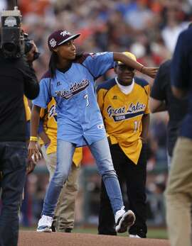 Little League pitcher Mo'ne Davis throws out the first pitch before Game 4 of the World Series at AT&T Park on Saturday, Oct. 25, 2014 in San Francisco, Calif.