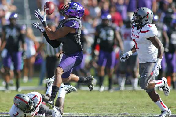 Kolby Listenbee joins in the TCU offensive fireworks by hauling in a 54-yard pass against Texas Tech's J.J. Gaines on Saturday.