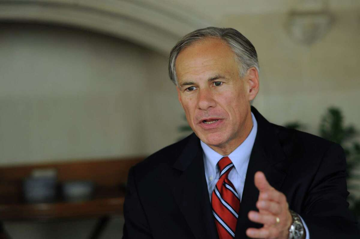 Texas Attorney General Greg Abbott, who is the Republican candidate for governor, visits the Express-News on Friday, Oct. 10, 2014.