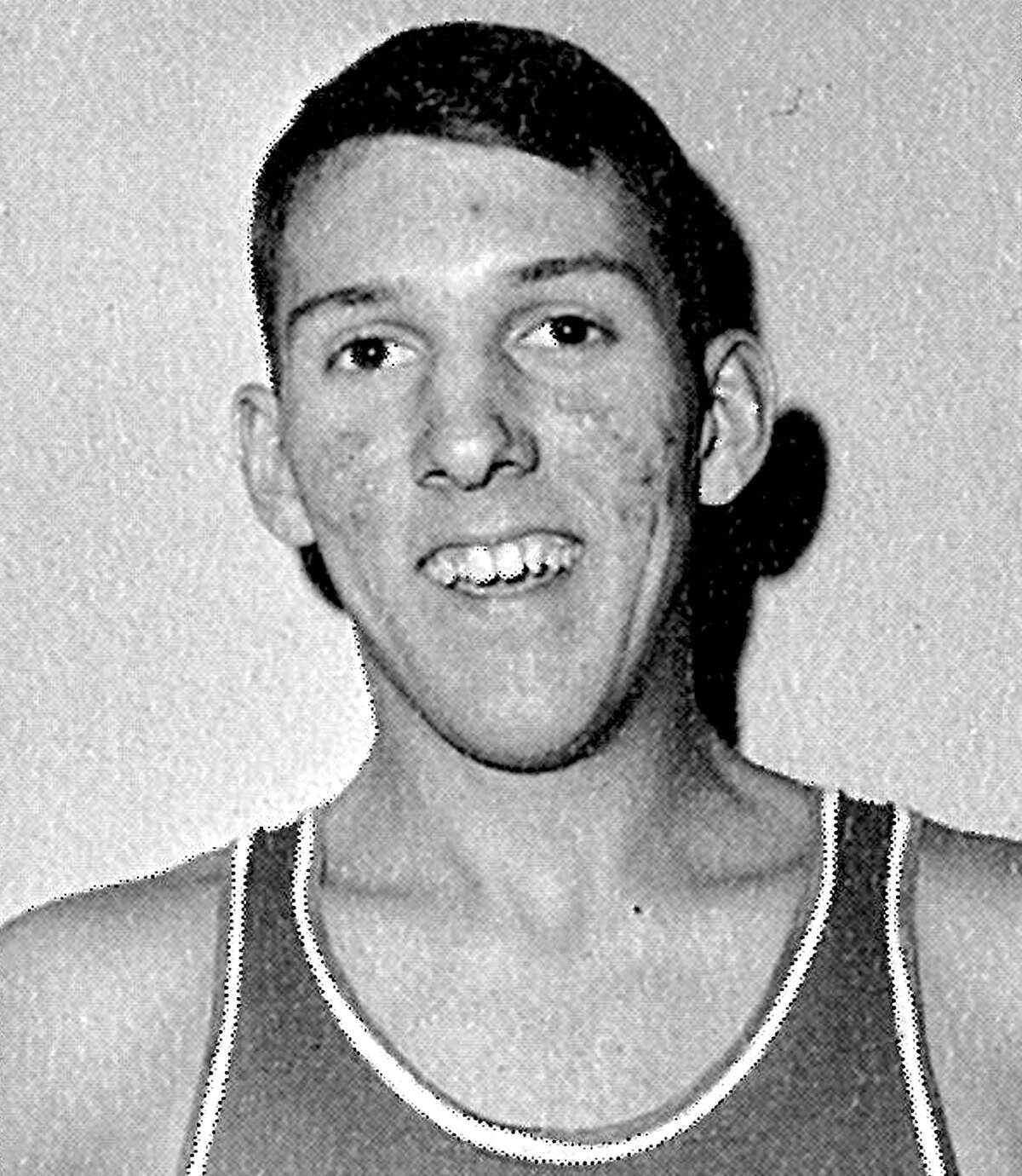 Popovich sports an Air Force Academy basketball jersey. He graduated with a degree in Soviet studies.