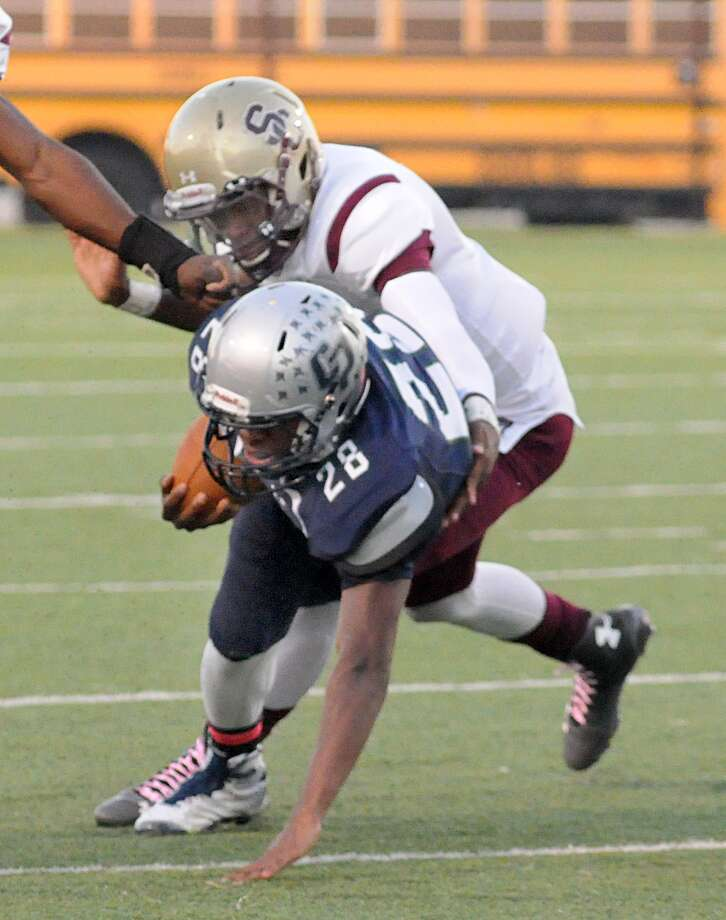 College Park's A.J. Sanders is tackled by Summer Creek's Julius Perkins during the Summer Creek at College Park football at Woodforest Bank Stadium in Shenandoah. Photo: David Hopper, Freelance / freelance