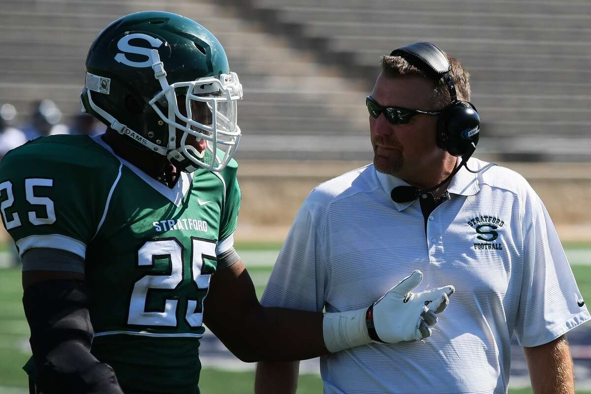 Stratford head coach Eliot Allen talks with his defensive back Jordyn Brooks on the sidelines of the Tomball Memorial game Saturday afternoon.