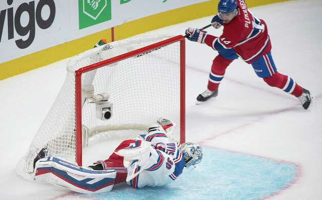 Montreal Canadiens' Tomas Plekanec, right, scores against New York Rangers goaltender Henrik Lundqvist during the first period of an NHL hockey game Saturday, Oct. 25, 2014, in Montreal. (AP Photo/The Canadian Press, Graham Hughes) ORG XMIT: GMH118 Photo: Graham Hughes / The Canadian Press