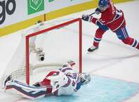 Montreal Canadiens' Tomas Plekanec, right, scores against New York Rangers goaltender Henrik Lundqvist during the first period of an NHL hockey game Saturday, Oct. 25, 2014, in Montreal. (AP Photo/The Canadian Press, Graham Hughes) ORG XMIT: GMH118